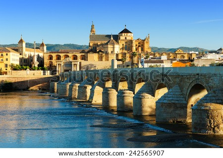 morning view of Romano Bridge and  Mosque-Cathedral, Cordoba, Spain. - stock photo