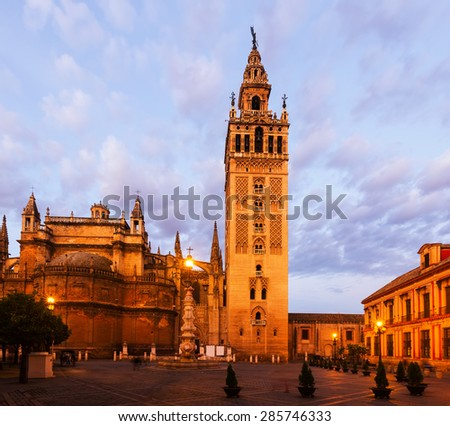 Morning view of  Seville Cathedral with Giralda tower. Spain  - stock photo