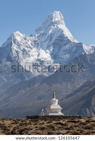 Morning view of the Ama Dablam (6814 m) and buddhist stupa - Nepal, Himalayas - stock photo