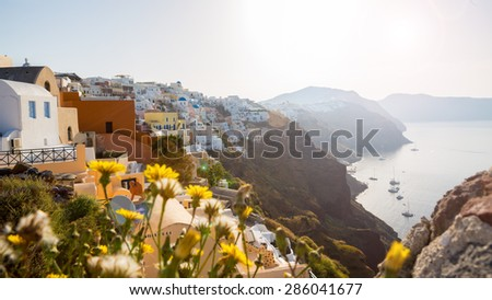 Morning view of the sea and the yachts Santorini Greece. white-blue Santorini - view of caldera with domes and flowers - stock photo