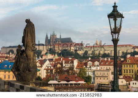 Morning view to the lesser town and the Prague Castle from Charles Bridge - stock photo