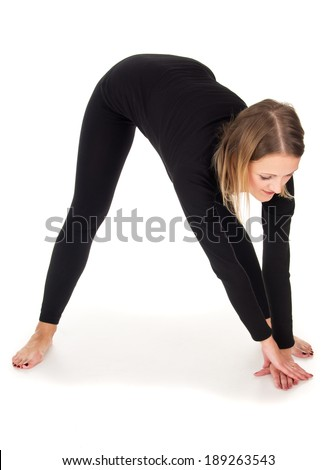 Morning warm-up, the girl does exercises - stock photo