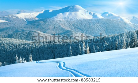 Morning winter calm mountain landscape with ski track and sunshine (Goverla view - the highest mount in Ukrainian Carpathian). Four shots stitch image, 16 to 9 wide propotions. - stock photo