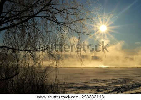 Morning winter mist on the river (soft focus processing) - stock photo