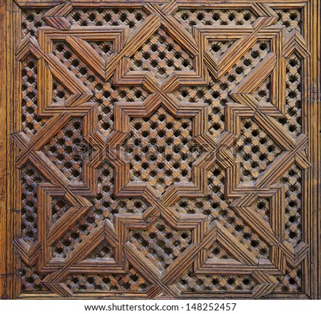 Moroccan carved wood panel on a door in Fes, Morocco - stock photo