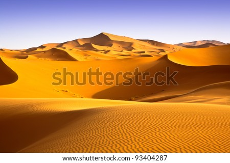 Moroccan desert landscape with blue sky. Dunes background. - stock photo