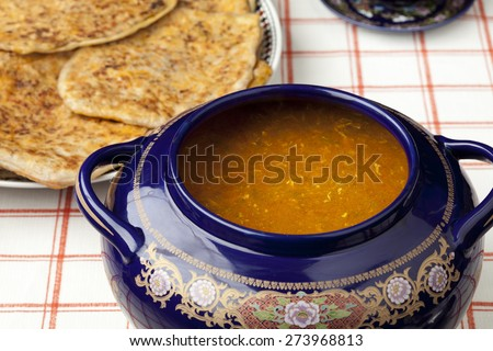 Moroccan harira soup and filled pancakes for ramadan - stock photo