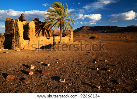Moroccan kasbah ruins in Middle Atlas Mountains, Africa - sunset light - stock photo