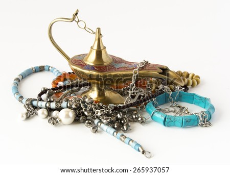 Moroccan oil lamp and bijouterie isolated - stock photo