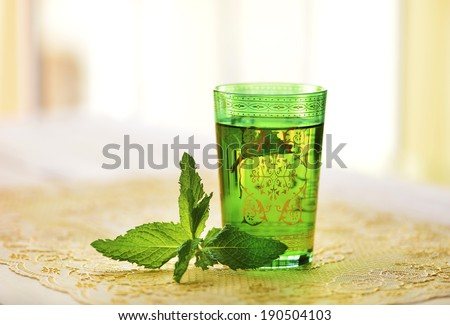 Moroccan tea with mint leaves - stock photo