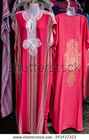 Moroccan traditional women dresses, clothes, national costume on dummy. - stock photo