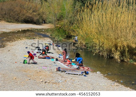 MOROCCO, AFRICA - MARCH 2, 2016: Women washing their clothes on a small river in Morocco, Africa - stock photo
