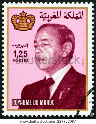 MOROCCO - CIRCA 1984: A stamp printed in Morocco shows King Hassan II, circa 1984.  - stock photo
