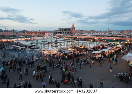 MOROCCO  - DEC 12: The famous night market in Marrakech in Morrocco on Dec,9,2012. This market attracted locals and torists by goods,foods, and the street shows - stock photo