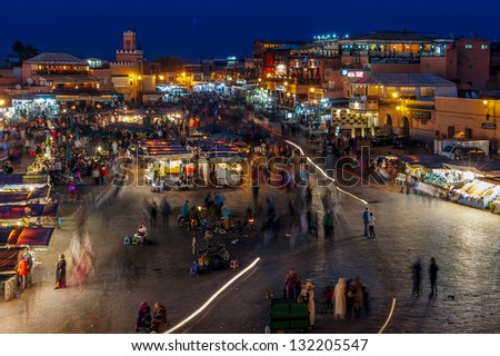 MOROCCO-DEC 24:The Night Market in the famous medina, a UNESCO site, in Marrakech, Morocco on Dec. 24, 2012. In the evening the square fills with food stands, attracting crowds of locals and tourists. - stock photo