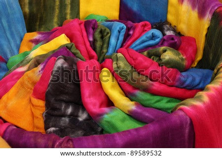 Morocco Essaouira typical colorful tie-dye scarves in the historic Kasbah - stock photo