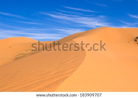 MOROCCO - JANUARY 10, 2014: Sahara desert dunes, white clouds - stock photo