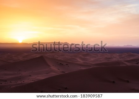 MOROCCO - JANUARY 10, 2014: Sunset over the Sahara desert - stock photo