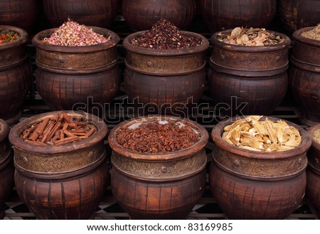 Morocco Marrakesh Spices, herbs and dried rosebuds in one of the medina's many souks - stock photo