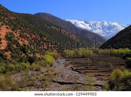 Morocco Marrakesh The High Atlas Mountain range and a fertile river valley in the Toubkal National Park - stock photo