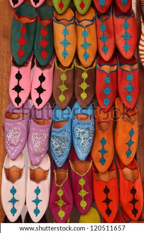 Morocco, Marrakesh, Typical colorful 'babuchas' - hand crafted leather slippers on display in the Medina souk - stock photo
