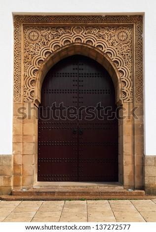 Morocco, Rabat, UNESCO World Heritage site - Beautiful historical Arabesque mosque doorway. Sandstone engraved. - stock photo