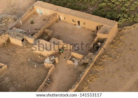 Morocco settlement in the desert near Marrakech aerial view - stock photo