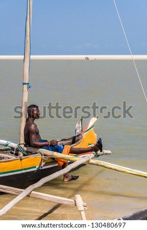 MORONDAVA, MADAGASCAR, OCT 29: Unidentified malagasy man of ethnicity Vezo on his fishing canoe on oct 29, 2007 to Morondava, western Madagascar - stock photo
