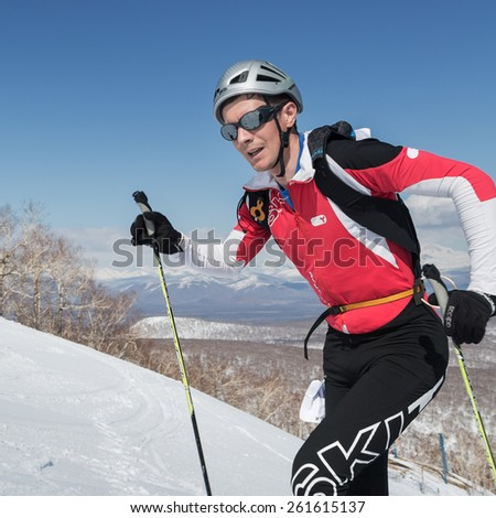 MOROZNAYA MOUNT, KAMCHATKA, RUSSIA - APRIL 25, 2014: Ski mountaineer Alexey Malt?ev climb on skis on mountain. Vertical race ski mountaineering Asian, ISMF, Russian, Kamchatka Championship. - stock photo