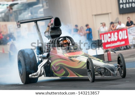 MORRISON, CO - JUNE 15:  A Top Dragster  does a burnout during Thunder on the Mountain presented by Grease Monkey at Bandimere Speedway on June, 15, 2013 in Morrison, Co.  - stock photo