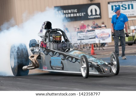 Morrison, CO - June 15, 2013: Top Dragster Anthony Stark Car 5301 does a burnout during Thunder on the Mountain presented by Grease Monkey at Bandimere Speedway. - stock photo