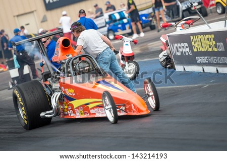 MORRISON, CO - JUNE 15:  Top Dragster Car 5632 driven by Johnny Bates gets a last checkout by crewmenber during Thunder on the Mountain presented by Grease Monkey at Bandimere Speedway on June, 15, 2013 in Morrison, Co.  - stock photo