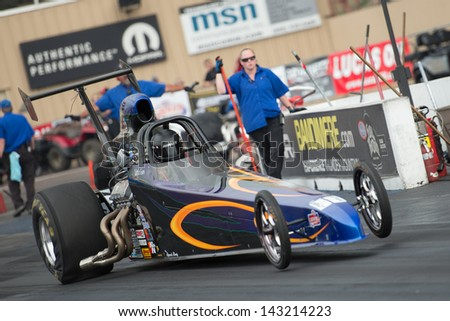 MORRISON, CO - JUNE 15: Top Dragster Car wheelies at the start line during Thunder on the Mountain presented by Grease Monkey at Bandimere Speedway on June, 15, 2013 in Morrison, Co.  - stock photo