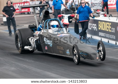 MORRISON, CO - JUNE 15: Top Dragster Megan Rhodes Car 577 wheelies at the start line during Thunder on the Mountain presented by Grease Monkey at Bandimere Speedway on June, 15, 2013 in Morrison, Co.  - stock photo