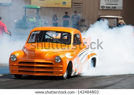 Morrison, CO - June 16, 2013: Top Sportsman Car 5648 does a burnout during Thunder on the Mountain presented by Grease Monkey at Bandimere Speedway. - stock photo