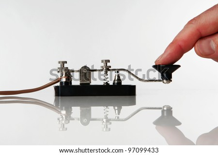 morse code key on a white background with someone sending a message - stock photo