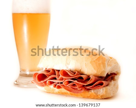 Mortadella sandwich and beer. - stock photo