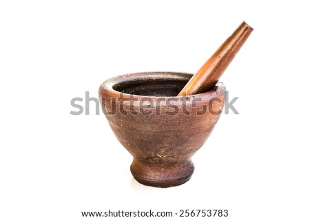 Mortar and pestle made from rock - stock photo
