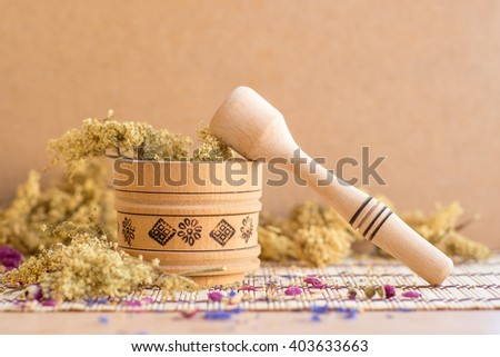 Mortar and pestle. Natural cosmetic. Alternative medicine, traditional medicine. Dried flowers elderberry. - stock photo