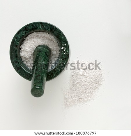 Mortar & Pestle with Pulverized Egg Shells - stock photo