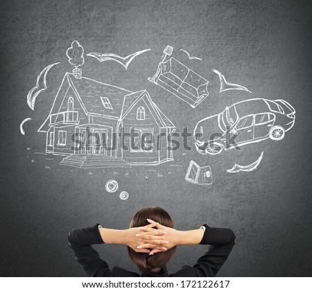 Mortgage and credit concept. Young woman planning her future - stock photo