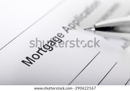 Mortgage application form close up with pen. selective focus, shallow depth of field - stock photo