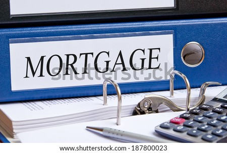 Mortgage - blue binder in the office - stock photo