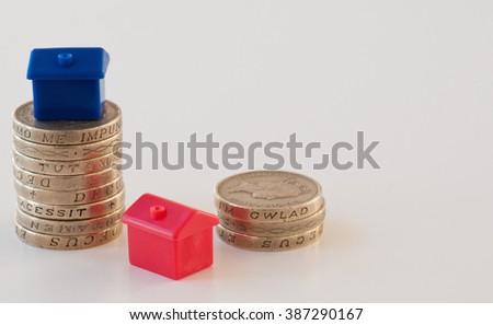 Mortgage concept inflated house prices - stock photo
