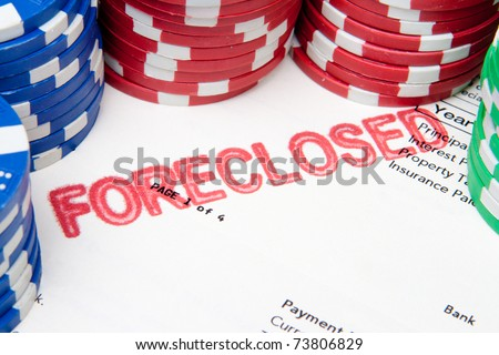 "Mortgage document with ""foreclosed"" stamped on it, surrounded by poker chips.  Suggesting the current US mortgage crisis. - stock photo"