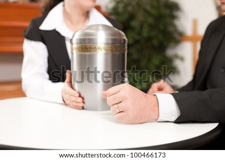 mortician with client comforting and advising - stock photo