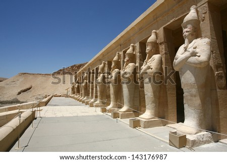 Mortuary Temple of Hatshepsut, near the Valley of the Kings, in Luxor, Egypt. A row of statues of Queen Hatshepsut as Osiris - stock photo