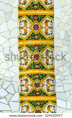 Mosaic at the exterior Parc Guell designed by Antoni Gaudi located on Carmel Hill, Barcelona, Spain. - stock photo