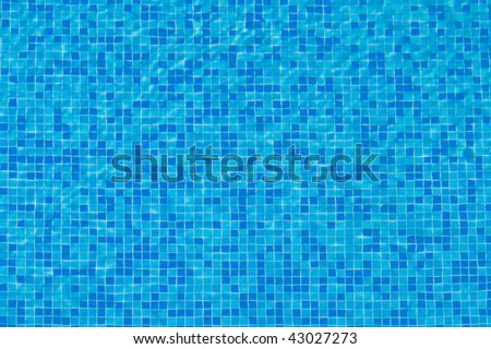 mosaic bottom of swimming pool watched through the water - stock photo