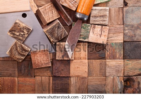 Mosaic from the old hard wood and chisels - stock photo